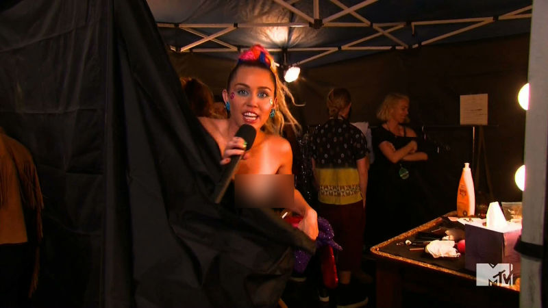Miley cyrus shows boobs at party