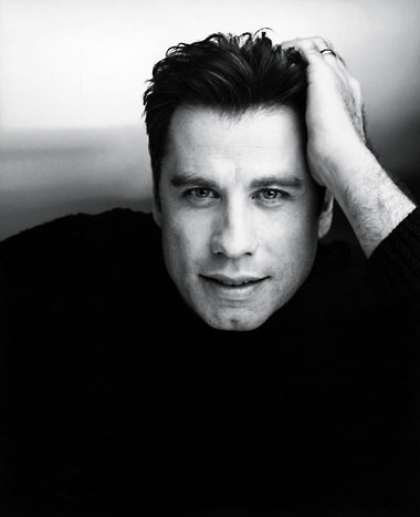 Can someone explain to me about John Travolta and his son and something about Scientology?