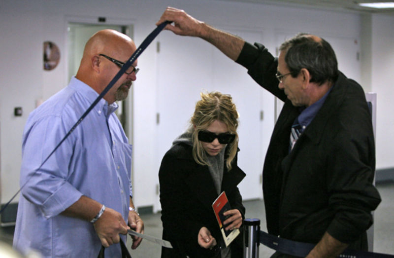 Click to viewBoomp3.com Pint size media mogul Ashley Olsen took further  advantage of her mogul status as she cut through the line at LAX early on  Tuesday ...
