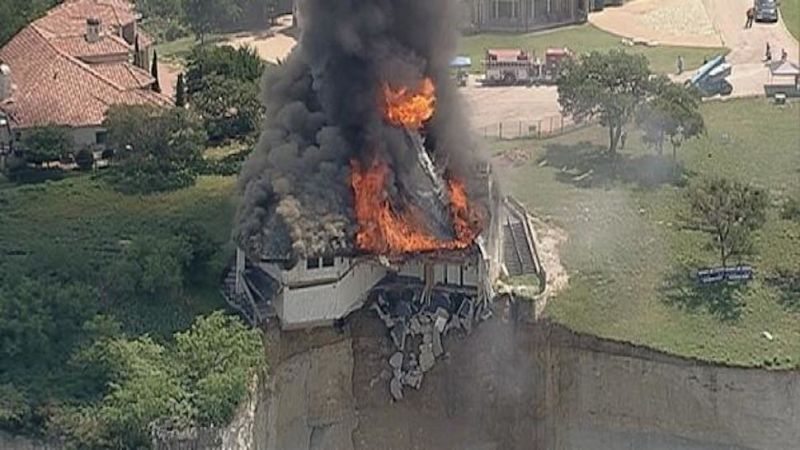 Mansion Falling Off Cliff Is Now Burning Off Cliff