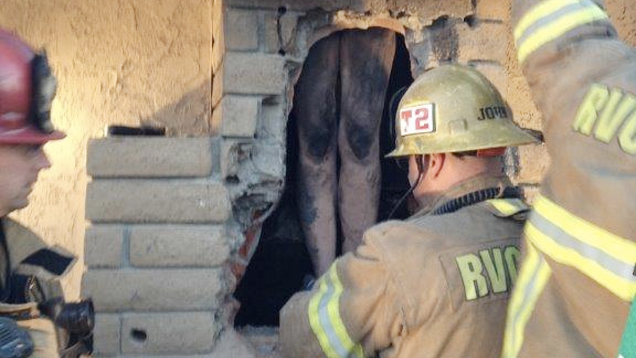 Fire Crew Frees Naked Woman Trapped Sneaking Down Ex-BFs