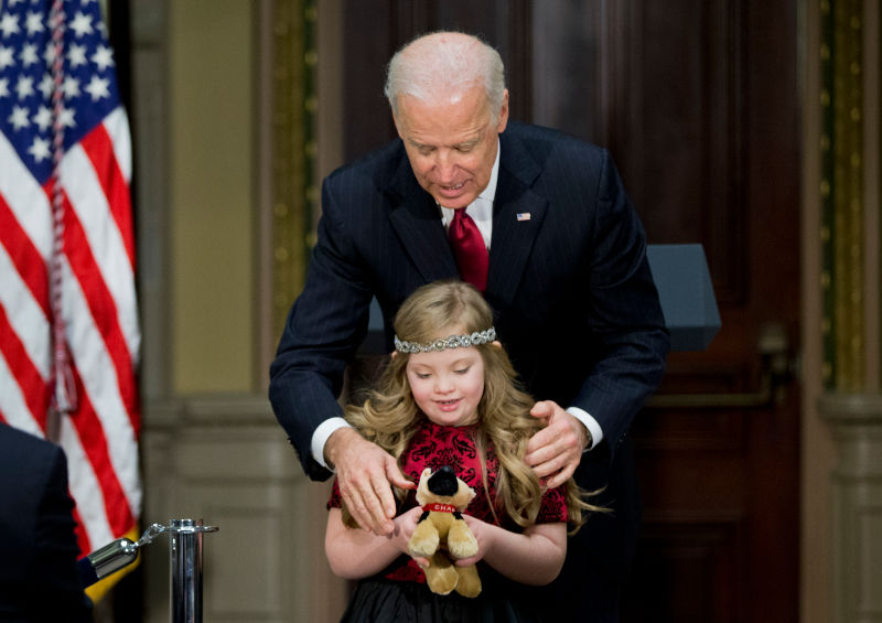 Image result for image of joe biden touching